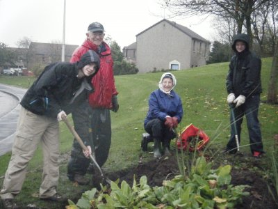 Digging Community flowerbeds in Cove